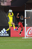 WASHINGTON, DC - AUGUST 25: Cristian Penilla #70 of New England Revolution makes a save from Ola Kamara #9 of D.C. United during a game between New England Revolution and D.C. United at Audi Field on August 25, 2020 in Washington, DC.