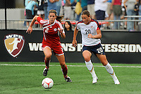 Abby Wambach (20) of the United States (USA) is chased by Emily Zurrer (2) of Canada (CAN). The United States (USA) Women's National Team defeated Canada (CAN) 1-0 during an international friendly at Marina Auto Stadium in Rochester, NY, on July 19, 2009.