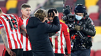 Brentford Manager, Thomas Frank, congratulates  Tariqe Fosu, scorer of their winning goal, at the final whistle as Sky TV Cameras capture the moment during Brentford vs AFC Bournemouth, Sky Bet EFL Championship Football at the Brentford Community Stadium on 30th December 2020