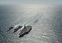 120306-N-DR144-945 ARABIAN GULF (March 6, 2012) The Nimitz-class aircraft carrier USS Carl Vinson (CVN 70) and the Ticonderoga-class guided missile cruiser USS Bunker Hill (CG 52) conduct replenishment-at-sea with the fast combat support ship USNS Bridge (T-AOE 10) as the British Navy destroyer HMS Daring (D 302) approaches. Carl Vinson and Carrier Air Wing (CVW) 17 are deployed to the U.S. 5th Fleet area of responsibility.  (U.S. Navy photo by Mass Communication Specialist 2nd Class James R. Evans/Released).