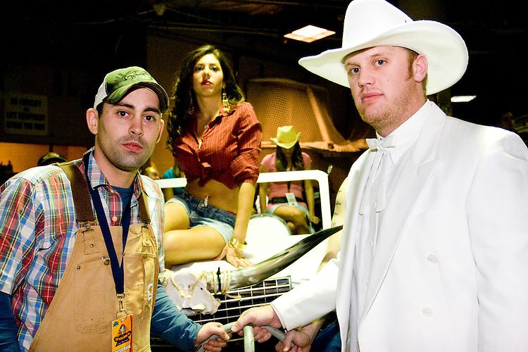 """""""Boss Hog"""", right, prepares to leave the backstage area on his float at the 14th annual Wing Bowl, held in Philadelphia on February 3, 2006 at the Wachovia Center.<br /> <br /> The Wing Bowl is a competitive eating event in which eaters try and down the most hot wings in 30 total minutes in front of a crowd of 10,000 plus people.  The real show however is all around the eaters, from the various scantily clad women (known as """"Wingettes"""") that make up eaters' entourages, to the behavior of the fans themselves."""