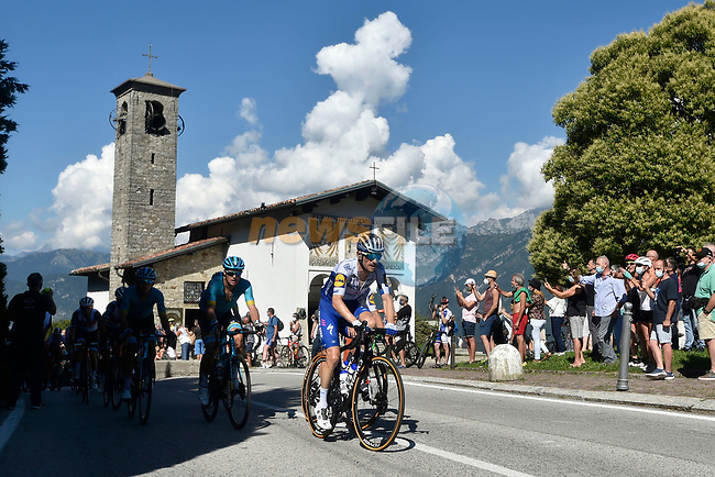The lead group led by Dries Devenyns (BEL) Deceuninck-Quick Step summit the Madonna del Ghisallo during the 114th edition of Il Lombardia 2020, running 231km from Bergamo to Como, Italy. 15th August 2020.<br /> Picture: LaPresse/Fabio Ferrari | Cyclefile<br /> <br /> All photos usage must carry mandatory copyright credit (© Cyclefile | LaPresse/Fabio Ferrari)