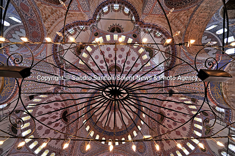 Pictured: The Blue Mosque in Istanbul, Turkey. <br /> <br /> A series of photographs of ceilings from historic buildings show off kaleidoscopic patterns.  Italian photographer Sandro Santioli captured the mesmerising and intricately decorated interiors of some of Istanbul's grandest places of worship.<br /> <br /> The symmetry of the designs adorning ceilings in Topkapı Palace, Sultan Ahmed Mosque and Hagia Sophia Grand Mosque create kaleidoscopic patterns.  As well as Istanbul, Turkey, Mr Santioli photographed ceilings at the Amber Fortress in Jaipur, India.  SEE OUR COPY FOR DETAILS. <br /> <br /> Please byline: Sandro Santioli/Solent News<br /> <br /> © Sandro Santioli/Solent News & Photo Agency<br /> UK +44 (0) 2380 458800