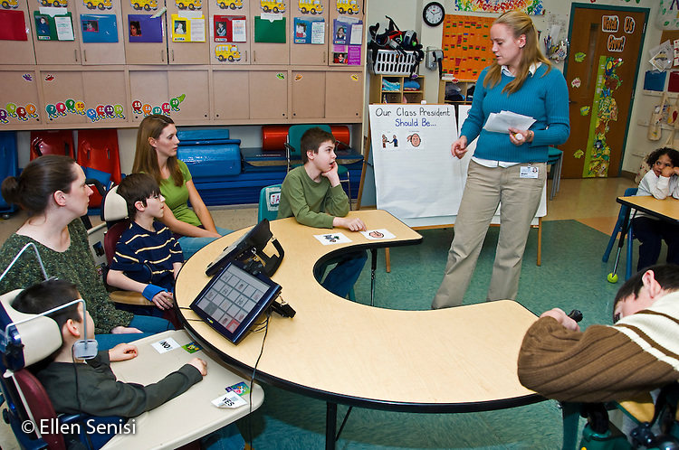 MR / Albany, NY.Langan School at Center for Disability Services .Ungraded private school which serves individuals with multiple disabilities.Special education teacher leads speech and language development lesson. Students are either nonverbal or have expressive and receptive language delays and several use alternative and augmentative communication devices. This lesson is focused on electing a class president. .MR: AH-cfds.© Ellen B. Senisi