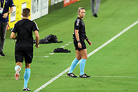 NASHVILLE, TN - SEPTEMBER 23: Referee Tori Penso winks at assistant referee Logan Brown while warming up before a game between D.C. United and Nashville SC at Nissan Stadium on September 23, 2020 in Nashville, Tennessee.