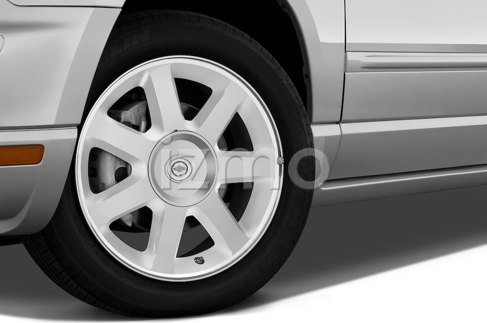 Tire and wheel close up detail view of a 2009 Chrysler Pacifica Touring