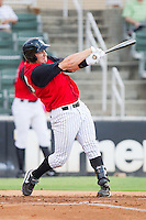 Ian Gac #33 of the Kannapolis Intimidators follows through on his swing against the Hickory Crawdads at Fieldcrest Cannon Stadium August 18, 2010, in Kannapolis, North Carolina.  Photo by Brian Westerholt / Four Seam Images