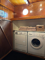 BNPS.co.uk (01202) 558833. <br /> Pic: Zeewarriors/BNPS<br /> <br /> Pictured: Utility room. <br /> <br /> A 100-year old Dutch sailing barge moored in Bermondsey has gone on sale for £278,000.<br /> <br /> The 25-metre MV Johanna Elisabeth was originally constructed in 1913 at Appelo, Zwartsluis in Holland, and was brought to the UK in 2003 by a previous owner.<br /> <br /> Her work as a sailing barge included shipping freight but she is now moored at the South Dock Marina in Bermondsey, south London, and used as a home.