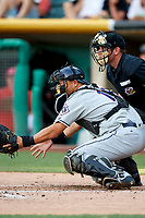 Hank Conger (16) of the Reno Aces on defense against the Salt Lake Bees with home plate umpire Bryan Fields making the calls in Pacific Coast League action at Smith's Ballpark on June 15, 2017 in Salt Lake City, Utah. The Aces defeated the Bees 13-5. (Stephen Smith/Four Seam Images)