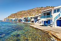 "Traditional fishermen houses with the impressive boat shelters, also known as ""syrmata"" in Klima of Milos, Greece"