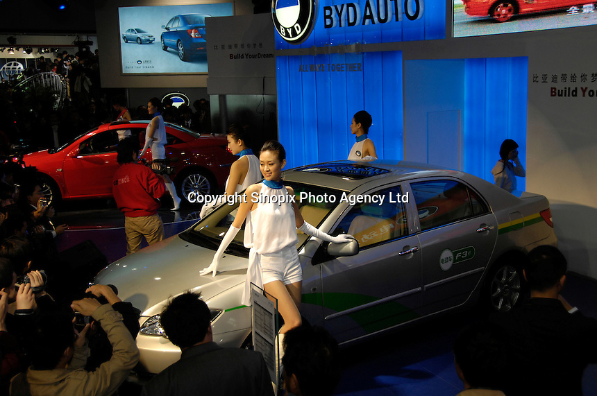 BYD F3e EV car and F8(red) at the 2006 International Automotive Exhibition in Beijing, China.