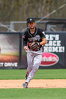 Lansing Lugnuts shortstop Kevin Smith (4) gathers to throw to first base during a Midwest League game against the Wisconsin Timber Rattlers on May 8, 2018 at Fox Cities Stadium in Appleton, Wisconsin. Lansing defeated Wisconsin 11-4. (Brad Krause/Four Seam Images)