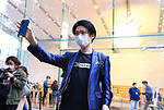 October 23, 2020, Tokyo, Japan - A customer displays his iPhone 12 Pro as he purchased the new 5G iPhone at an Apple store in Tokyo on Friday, October 23, 2020. iPhone 12 and iPhone 12 Pro started to sell here while iPhone 12 Pro Max and iPhone 12 mini will go on sale next month.        (Photo by Yoshio Tsunoda/AFLO)