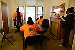 """Cease Fire outreach workers and violence interrupters (l-r) James Sima, 39, Donya Smith, 26, Jerusha """"Rue"""" Hodge, 42, and supervisor Ulysses """"US"""" Floyd finishing up a briefing in their office on recent developments in the neighborhoods where they work with at risk youth participants on the far South Side of Chicago, Illinois on February 3, 2017.  Cease Fire is a public health initiative that attempts to stop or halt gun violence across the city."""