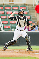 Kannapolis Intimidators catcher Jeremy Dowdy (23) makes a throw to second base during the South Atlantic League game against the Greensboro Grasshoppers at CMC-Northeast Stadium on July 12, 2013 in Kannapolis, North Carolina.  The Grasshoppers defeated the Intimidators 2-1.   (Brian Westerholt/Four Seam Images)