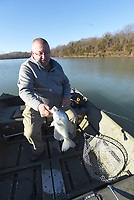 Another hefty crappie is on its way  March 4 2021 to McBride's livewell.<br />(NWA Democrat-Gazette/Flip Putthoff)