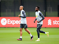 14th September 2021: The  AXA Training Centre , Kirkby, Knowsley, Merseyside, England: Liverpool FC training ahead of Champions League game versus AC Milan on 15th September: Fabinho of Liverpool with team mate Divock Origi of Liverpool