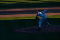 Cal McAninch (27) of the University of Toledo Rockets pitches as the sun casts shadows in a game against the University of South Carolina Upstate Spartans on Friday, February 19, 2021, at Cleveland S. Harley Park in Spartanburg, South Carolina. Upstate won, 14-2. (Tom Priddy/Four Seam Images)