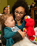 TORRINGTON, CT. 20 December 2019-122019BS09 - 16 month old Skylar Pitts plays with her Elmo stuffed animal given to her by Santa as she is held by her mother Jessica, during a visit by Santa at the FISH of Northwestern Connecticut Homeless Shelter in Torrington on Friday. Bill Shettle Republican-American