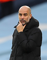 10th January 2021; Etihad Stadium, Manchester, Lancashire, England; English FA Cup Football, Manchester City versus Birmingham City; Manchester City manager Pep Guardiola follows the action from the touchline