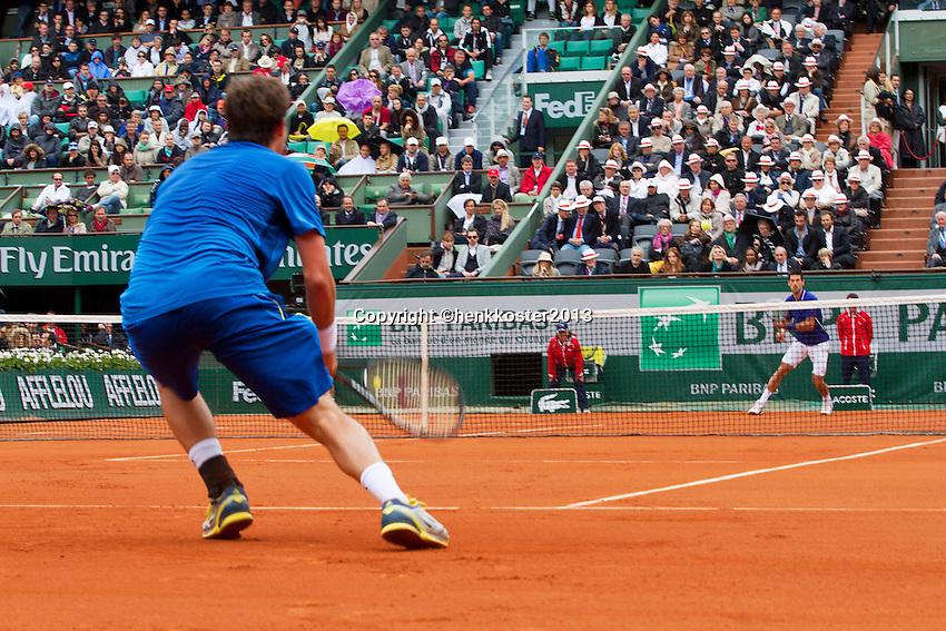 30-05-13, Tennis, France, Paris, Roland Garros,  Novak Djokovic vs Guido Pella(forground) on court Philippe Chatrier, (centercourt)