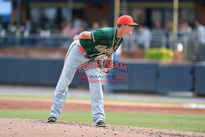 Greensboro Grasshoppers starting pitcher Brandon Miller (41) looks in for the signals during a game against the Asheville Tourists at McCormick Field on May 11, 2018 in Asheville, North Carolina. The Tourists defeated the Grasshoppers 10-5. (Tony Farlow/Four Seam Images)