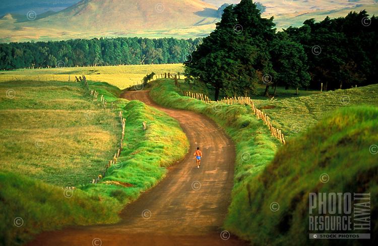 Lone man running on Mana Road on the Big Island