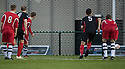 Shire's Paul Quinn (10) scores Shire's first goal from the penalty spot.