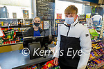 Peter Hinchliffe from Abbeydorney being looked after by Melissa O'Sullivan in Powers Shop in Abbeydorney on Thursday.