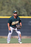 Hiro Nakajima #16 of the Oakland Athletics during a Minor League Spring Training Game against the Los Angeles Angels at the Los Angeles Angels Spring Training Complex on March 17, 2014 in Tempe, Arizona. (Larry Goren/Four Seam Images)