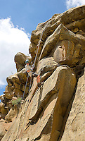 Photo story of Philmont Scout Ranch in Cimarron, New Mexico, taken during a Boy Scout Troop backpack trip in the summer of 2013. Photo is part of a comprehensive picture package which shows in-depth photography of a BSA Ventures crew on a trek.  In this photo BSA Venture Crew Scout rappells down the natural rock face at Dean Cow Camp, in the backcountry at Philmont Scout Ranch.   <br /> <br /> The  Photo by travel photograph: PatrickschneiderPhoto.com