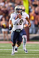 Navy quarterback Tago Smith (18) rushes with the ball during first half of NCAA Football game, Saturday, September 13, 2014 in San Marcos, Tex. Navy leads Texas State 28-7 at the halftime.(Mo Khursheed/TFV Media via AP Images)<br /> <br /> **CAPTION CORRECTION**<br /> <br /> Image submitted earlier had incorrect<br /> number and name of the ball carrier.