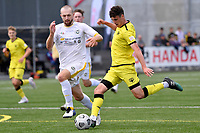 Riley Bidois of the Wellington Phoenix competes for the ball with Christian Gray of Eastern Suburbs during the ISPS Handa Men's Premiership - Wellington Phoenix v Eastern Suburbs at Fraser Park, Wellington on Saturday 28 November 2020.<br /> Copyright photo: Masanori Udagawa /  www.photosport.nz