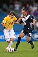 MELBOURNE, AUSTRALIA - NOVEMBER 06: Rodrigo Vargas of the Victory challenges Joel Porter of Gold Coast United during the round 13 A-League match between the Melbourne Victory and Gold Coast United at Etihad Stadium on November 6, 2010 in Melbourne, Australia (Photo by Sydney Low / Asterisk Images)