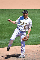 Salt Lake Bees relief pitcher Cory Rasmus (26) delivers a pitch to the plate against the El Paso Chihuahuas in Pacific Coast League action at Smith's Ballpark on July 26, 2015 in Salt Lake City, Utah. El Paso defeated Salt Lake 6-3 in 10 innings. (Stephen Smith/Four Seam Images)