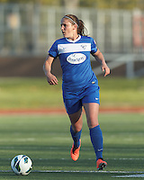 Boston Breakers defender Cat Whitehill (4) looks to pass. In a National Women's Soccer League Elite (NWSL) match, the Boston Breakers (blue) defeated Chicago Red Stars (white), 4-1, at Dilboy Stadium on May 4, 2013.