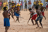 Kayapo participants demonstrate Ronkran, their version of hockey played using a babassu nut for a ball during the International Indigenous Games, in the city of Palmas, Tocantins State, Brazil. Photo © Sue Cunningham, pictures@scphotographic.com 24th October 2015