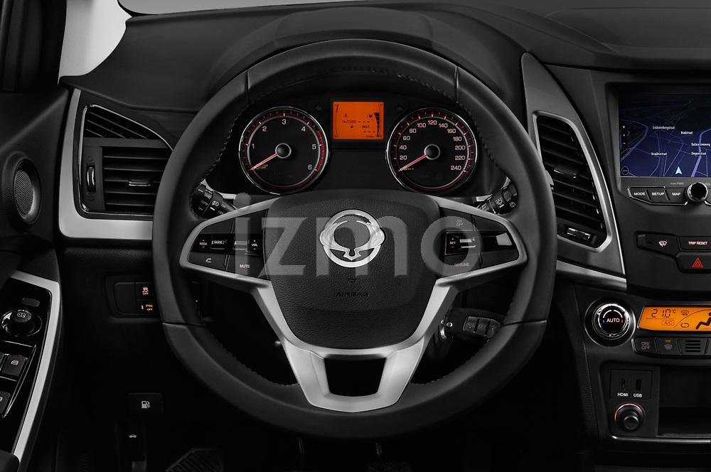 Car pictures of steering wheel view of a 2017 Ssangyong Korando Quartz 5 Door SUV