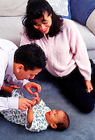 Hispanic parents and and infant play