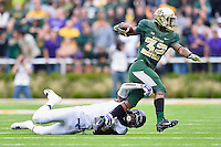 TCU safety Chris Hackett (1) attempts to bring down Baylor running back Shock Linwood (32) during an NCAA football game, Saturday, October 11, 2014 in Waco, Tex. Baylor defeated TCU 61-58 to remain undefeated in BIG 12 conference. (Mo Khursheed/TFV Media via AP Images)