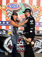 Sept. 2, 2013; Clermont, IN, USA: NHRA top fuel dragster driver Shawn Langdon celebrates with mother Debbie Langdon after winning the US Nationals at Lucas Oil Raceway. Mandatory Credit: Mark J. Rebilas-