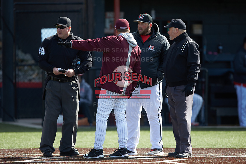Bellarmine Knights head coach Larry Owens points as he discusses the ground rules with North Greenville Crusaders head coach Landon Powell at Ashmore Park on February 7, 2020 in Tigerville, South Carolina. The Crusaders defeated the Knights 10-2. (Brian Westerholt/Four Seam Images)