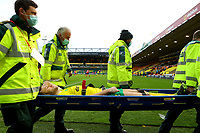 20th March 2021; Carrow Road, Norwich, Norfolk, England, English Football League Championship Football, Norwich versus Blackburn Rovers; Ben Gibson of Norwich City is stretchered off with an injury