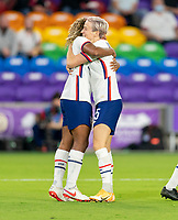 ORLANDO, FL - JANUARY 22: Catarina Macario #29 of the USWNT celebrates with Megan Rapinoe #15 during a game between Colombia and USWNT at Exploria stadium on January 22, 2021 in Orlando, Florida.