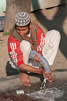 Madrasa Student Doing his Laundry after Class, Madrasa Imdadul Uloom, Dehradun, India.