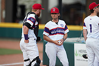 Winston-Salem Rayados pitching coach Danny Farquhar (center) listens to catcher Gunnar Troutwine (12) prior to the game against the Llamas de Hickory at Truist Stadium on July 6, 2021 in Winston-Salem, North Carolina. (Brian Westerholt/Four Seam Images)