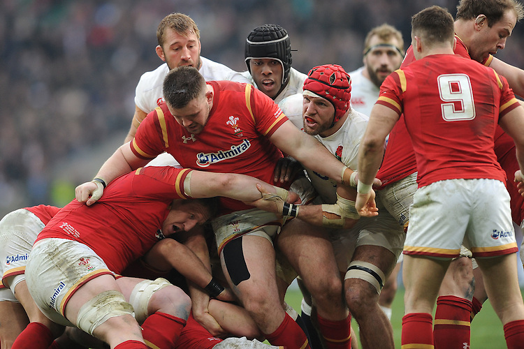 Chris Robshaw, Maro Itoje and James Haskell of England work hard in the breakdown during the RBS 6 Nations match between England and Wales at Twickenham Stadium on Saturday 12th March 2016 (Photo: Rob Munro/Stewart Communications)