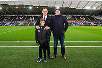 Lee Trundle with the new Swansea city scholar during the Sky Bet Championship match between Swansea City and Middlesbrough at the Liberty Stadium in Swansea, Wales, UK. Saturday 14 December 2019