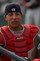 Catcher Luis Exposito of the Salem Red Sox in dugout with mask off against  the Myrtle Beach Pelicans on May 3, 2009