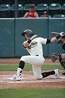 Renae Martinez (9) of the Visalia Rawhide bats against the Modesto Nuts at Recreation Ballpark on June 10, 2019 in Visalia, California. (Larry Goren/Four Seam Images)